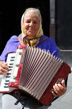 Old Woman playing Accordion