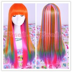 Long Rainbow Straight Wig wear with some some nicki minaj fake eyelashes and some white high heels with platforms. (and white outfit)