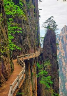 11 spectacular cliff paths from around the world - including picture shown of Huangshan Paths, China.