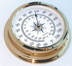 """Solaris Hybrid Analog Thermometer  Features: Solid brass with lacquered finish for use onshore Glass lens Dial diameter: 6.375"""" Weight: 8.5 oz.  $150.00"""