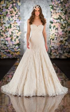 Exquisite Martina Liana designer lace A line wedding dress includes Alencon Lace and Tulle over rich Dolce Satin with Diamante details. (Style 516)