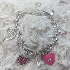 New charm bracelet set Brand new with tags. Smoke free home. Silver tone bracelet with pink heart charms Jewelry Bracelets