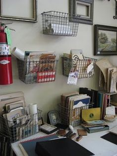 creative storage -- Pinner says: just found some black plastic coated wire baskets at TJMaxx to hang on wall :) only 3.99 each!