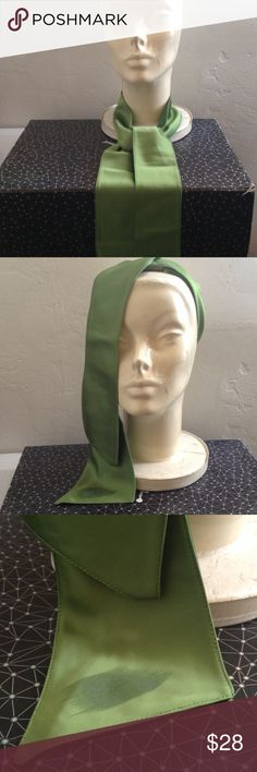 """🆕 Vintage Emerald Green Satin Neck Tie Head Band Vintage Emerald Green Women's Necktie - Satin/Silk Blend material. Shiny on one side and matte on the flip side. There's a sticker stain from the price tag on the tip and 2 small """"wet"""" marks . Shown in photos. Measures 54 inches long. Rated 3/5. Fabric can easily be cleaned to resolved wet marks. Vintage Accessories Scarves & Wraps"""