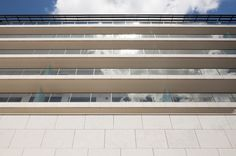 This high quality urban development features minimalist modern architecture and is located in a prime location, close to Amoreiras shopping, a centre of. Modern Minimalist, Lisbon, Modern Architecture, Facade, Blinds, Buildings, Nova, Luxury, Outdoor Decor