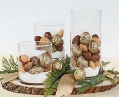Gold painted Diamond In-Shell Walnuts surround white candles in glass holders to make this sophisticated and beautiful holiday centerpiece. Holiday Centerpieces, Rustic Centerpieces, Holiday Tables, Christmas Decorations, Holiday Decorating, Gold Spray Paint, Mixed Nuts, Glass Holders, White Candles