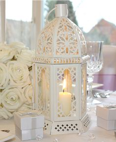 Buy a decorative table lantern, with stylish cut out design at Wedding Ideas Magazine. This table lantern is cream and features glass sides to protect the candle flame. Can be used with tealights or small candles. Table Lanterns, Wedding Lanterns, Wedding Table Flowers, Table Centerpieces, Wedding Decorations, Wedding Ideas, Wedding Centrepieces, Wedding Inspiration, Centrepiece Ideas