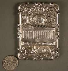 """American Coin Silver """"castle top"""" calling card case with architectural view, attributed to Leonard & Wilson of Philadelphia. c1850"""