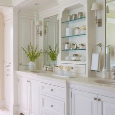 So pretty and clean. Like the cupboard-type medicine cabinet on the left sink. Probably a shallow one for razors and toothbrushes.