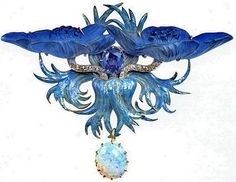 Rene Lalique, Peacock brooch. In the Symbolist style, two enamel feathers and diamonds frame a sapphire. Lighter blue enamel feathers hold an opal pendant.