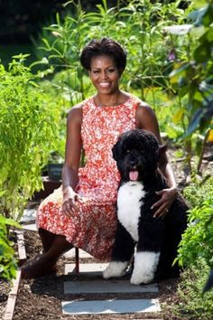 Mrs. Obama and Bo sitting in the garden