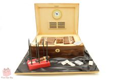 A humidor cake with all the accessories including a zippo lighter, cigar cutter, ashtray and of course cigars!  #birthday #cake
