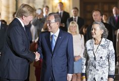 King Willem-Alexander of The Netherlands (L) greets United Nations Secretary General Ban Ki-moon and Yoo Soon-taek attends an event to mark the centennial anniversary of the Peace Palace at the Peace Palace on 28 Aug 2013 in The Hague, Netherlands.