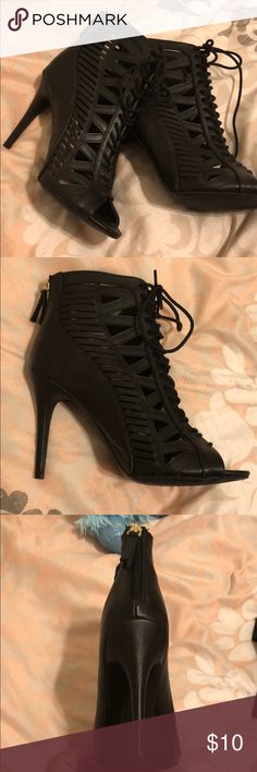Too tall for me sadly :( Cute, black heels 3-4 inch heel, basically new. Cool-cut outs in them. Anne Michelle Shoes Heeled Boots