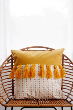 This pillow has yarn tassels! These are a fun decoration and really easy to make! Take a look at the tutorial!