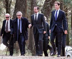 (L-R) King Constantine II his sons, Prince Nikolaos of Greece and Pavlos, Crown Prince of Greece attend a dirge and the Orthodox Mass in memory of King Paul in the cemetery at Tatoi Palace on the anniversary of his father King Paul I's death on 16.03.2015 in Athens, Greece