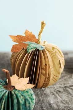 Paper pumpkin craft - can be used for place cards or table numbers #thanksgiving #wedding #decorations