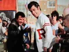 Danny in his Rydell High Letterman Sweater