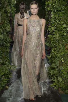 """""""Promise of Spring"""", dress in swamp colored muslin with motifs of buttercups, clovers and golden embroidery."""