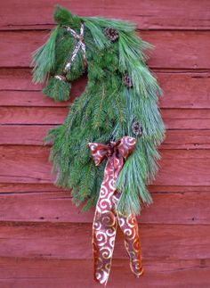 "Classy Horsehead Wreath / Swag by professional equine artist Kathy Morawski. Inspired by the elegance of Friesian horses  made of REAL pine evergreens, pine cones, etc.! Great horse lovers gifts & elegant Christmas holiday horse decor! Available in Mystic Mare Etsy shop. To see companies that featured my wreaths & keep up with the latest, ""Like"" my Facebook page: ""Horsehead Wreaths by Professional Equine Artist"" at: https://www.facebook.com/MysticMareHorseHeadWreaths"