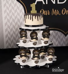 Our Mr. ONEderul 1st birthday theme includes personalized favors, tableware, and photo pops! Shop all our 1st birthday party ideas to make your little one's birthday extra special. Display sweet treats in these Mr. One-derful Personalized Cupcake Wrappers featuring a trendy patterned background with your custom text accented by a gold bow tie. Coordinate these cupcake wrappers with additional Mr. Onederful party supplies!