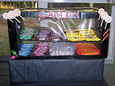 movie-night  Candy Concession Stand  Build your own candy concession stand out of a cardboard box.   Get the tutorial at Party Planning Mom.