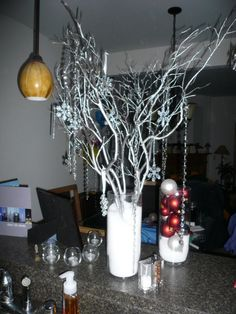 Idea on how to make the branches stand up. wedding reception centerpieces with branches | Centerpieces : wedding centerpiece diy green manzanita reception ... #wedding #centerpieces