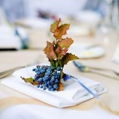 Natural berries dress up this neutral place setting.