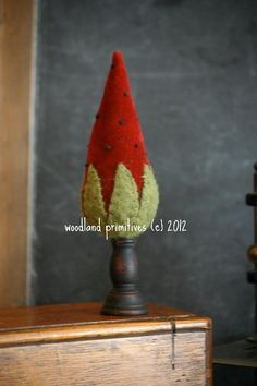 """$5 Strawberry Velveteen Pinkeep / pincushion.  5"""" overall ht the strawberry alone is 3.75""""tall. Tiny french knot seeds, cap made from wool felt, + antique candlestick as the base.  Complete, simple instructions. Also need stuffing, buttonhole thread, paint or stain if messing w/ candlestick.  See Woodland Primitives designs on Craftsy as they are all pretty + like this…"""