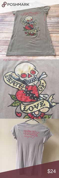 """Ed Hardy Christian Audigier Bling Cap Sleeve Tee This is a beautiful Ed Hardy by Christian Audigier Featuring """"Death of Love"""" Tattoo With Skull Heart and Roses Bling Rhinestones Cap Sleeve T-Shirt  This Shirt is in Excellent Condition, The color is a Army Khaki Brown Gray and it is made of 100% Cotton. This Shirt Size is XS The Bust measures 30"""" at the armpit Ed Hardy Tops Tees - Short Sleeve"""