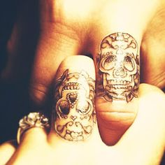 sugar skull tattoos, skull finger tattoos and skull tattoos. Skull Finger Tattoos, Finger Tattoo Designs, Couples Tattoo Designs, Sugar Skull Tattoos, Body Art Tattoos, Sugar Skulls, Candy Skulls, Knuckle Tattoos, Tatoos
