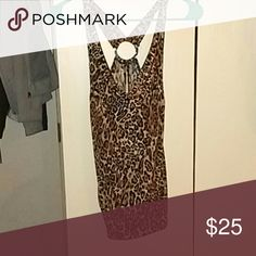 Cheetah print silky beautiful shirt! I have a cheetah print shirt slit in the back with a cross back that leads to a ring it is a stretchy material tighter on the bottom looset on the top will look great on the right person. Forever 21 Tops Blouses