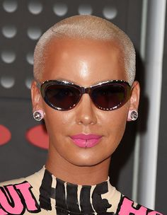 8bdc888f8923 Amber Rose s VMAs earrings are life itself. Rose Stencil
