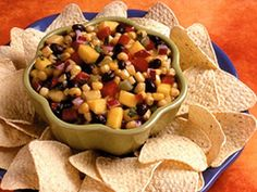 As if salsa wasn't exciting enough on its own with a fiesta of flavors and textures, this recipe for Mango Tango Black Bean Salsa will really get the party started, 'cause it gets an extra boost from refreshing diced mango! Black Bean Salsa, Black Beans, Great Recipes, Soup Recipes, Favorite Recipes, Appetizer Recipes, Snack Recipes, Appetizers, Kids Picnic Foods