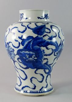 A Chinese baluster vase, century, painted to the neck with precious objects and to the body with lions chas. Willow Pattern, Country Blue, Vase Shapes, Ginger Jars, White Decor, Blue And White, Yellow, White Ceramics, Projects To Try