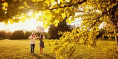The family in the park. Happy parents with children walk in the nature in the evening at sunset. Happy Parents, Local Library, New Community, Local Parks, Local History, Historical Society, Outdoor Entertaining, Dog Friends, Kids And Parenting