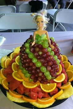 Barbie Fruit Cake would be perfect for Luau using a Hula Doll with long dark hair. First fruit shower idea Discover thousands of images about Watermelon and grape fruit Fruits Decoration, Fruit Creations, Creative Food Art, Food Carving, Vegetable Carving, Fruit Kabobs, Fruit Arrangements, Food Displays, Fruit Art