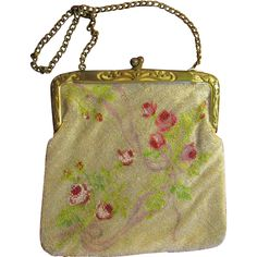 This is a very old, glass beaded handbag with a beautiful floral design and a fabulous frame. This gorgeous handbag measures 6 X 6-1/4. A wonderful