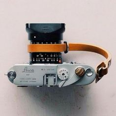 Vintage Leica camera with leather strap - Yes please