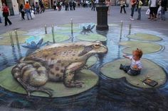 Chalk on the sidewalk! The shading, highlighting, making the light turn with the frog.  The effect of water's ripples, light to dark, reflection. All on a grand scale at the perfect angle to make the work come to life. It's absolutely amazing.