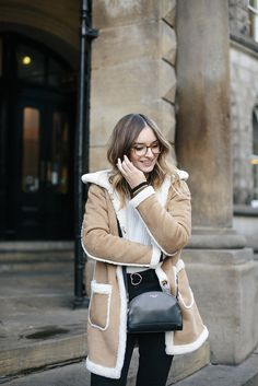 (Jacket: ASOS , Jumper: Topshop , Belt: ASOS , Jeans: Urban Outfitters , Boots: & Other Stories , Bag: Radley , Glasses: Bailey Ne...