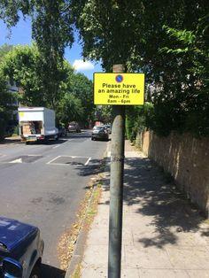 a slightly improved parking restriction sign.