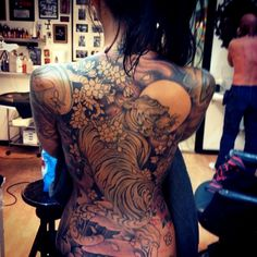 beautiful tiger body art idea of asian tattoo.For more cool and amazing tattoos, visit www.tattooenigma.com.