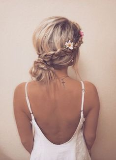 Messy braid bun with flower accents