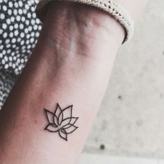 Small Lotus Flower Tattoo