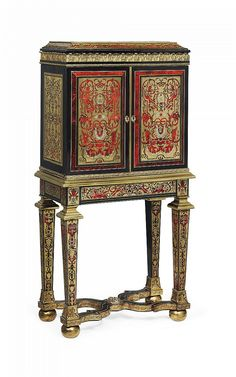 A REGENCY ORMOLU-MOUNTED TORTOISESHELL AND BRASS INLAID EBONY AND EBONISED 'BOULLE' COLLECTOR'S CABINET-ON-STAND<br />CIRCA 1815, SOME 'BOULE-WORK' EARLIER AND REUSED, ATTRIBUTED TO LOUIS LE GAIGNEUR<br />The upper part enclosing eight graduated drawers, the base with tapering square-section legs and ormolu ball feet joined by a x-stretcher, with paper label to the underside 'THE BA... LADY LAMB' and wax seal to the reverse with 'M' beneath a baron's coronet, lock replaced, old ...