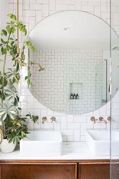 Giant mirror + brass fixtures #bathrooms #interiordesign #modern #tile