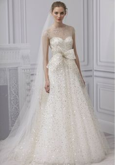 Monique Lhuillier - with a short blusher veil or understated head-piece.  there's a little too much happening in this dress with that long veil in my opinion