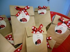 little gift bags for a lady bug party