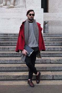The red jacket is emphasized when put together with the more subtle colors. the patterned scarf is also emphasized due to the solid colors it's paired with. - Israa Dief (FASN 1100)
